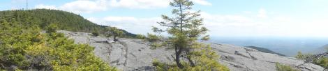 A panorama from a ledge halfway between the scenic road's parking lot and summit