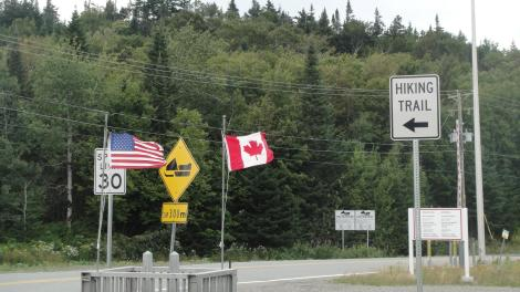 The trail to 4th Connecticut Lake follows the border and starts by going between the US and Canadian customs stations.