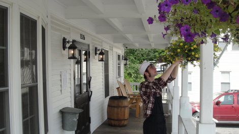 Tending the flowers at the Vernondale Store
