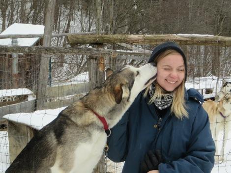 Emma gets a dog kiss